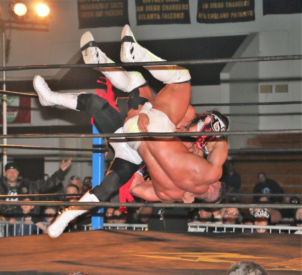 Bandido power slams Brian Cage to the mat.