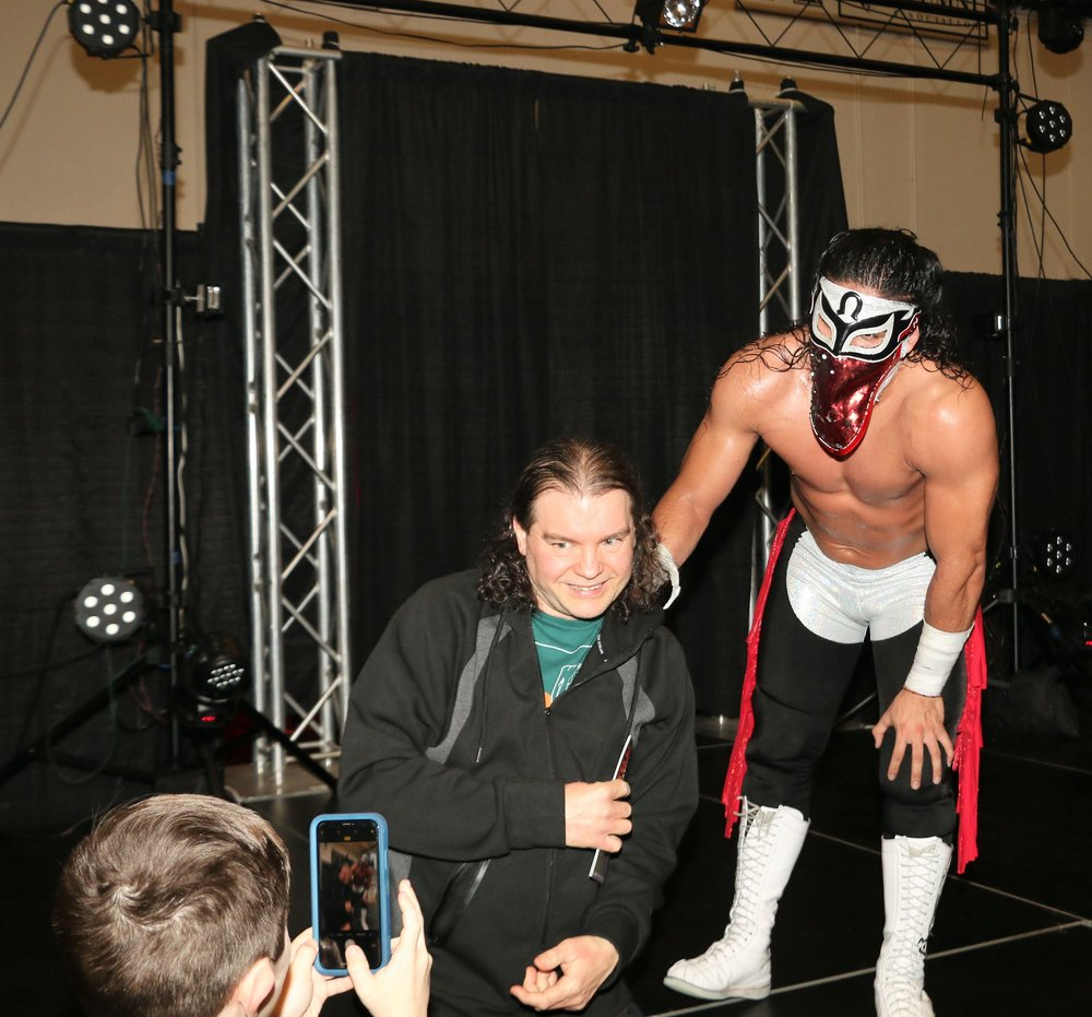 Despite the loss to Brian Cage, Bandido poses for a photograph with a fan.