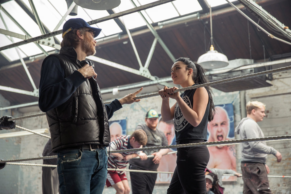 """Director Stephen Merchant, left, said he selected Florence Pugh from a group of about 16 young women to portray WWE Superstar Paige in the MGM Pictures film """"Fighting with My Family. (Photo by Robert Viglasky/Metro Goldwyn Mayer Pictures © 2018 Metro-Goldwyn-Mayer Pictures Inc. All Rights Reserved.)"""