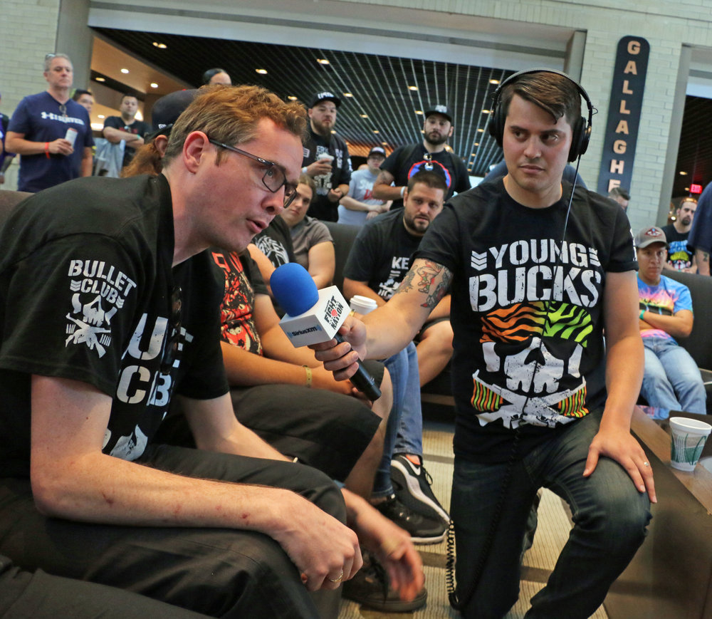 Busted Open producer Alex Metz, right, holds the mic for fan asking a question during the show's live remote at STARRCAST last summer in suburban Chicago.  (Photo by Mike Pankow)