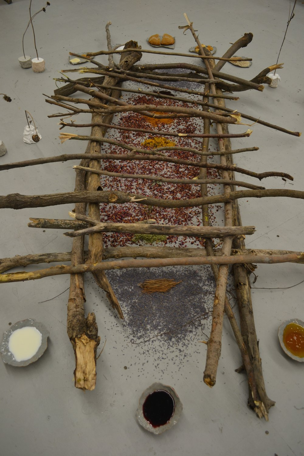 Baptism By Fire   Multimedia installation  Wine, milk, honey, herbs, bread, grains, salt, figs  Dead sunflowers, found wood, plaster, concrete, ceramics  2015