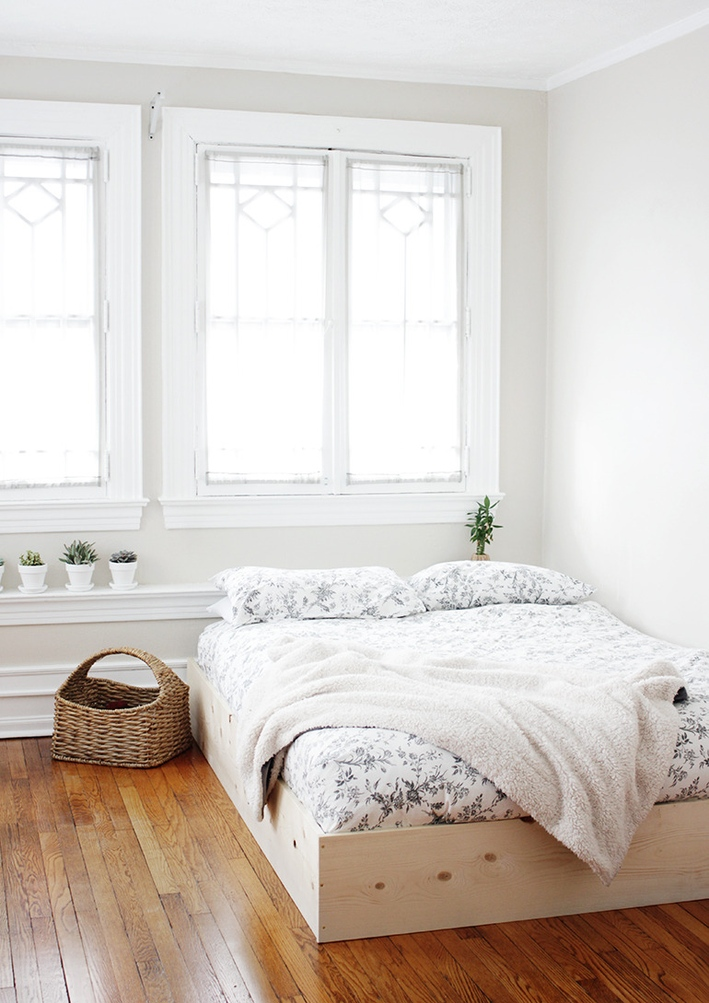 I think I am leaning towards something like this. Maybe a little higher, but the general idea. It lifts the bed, has clean lines, and you could add a cool headboard or something as well.