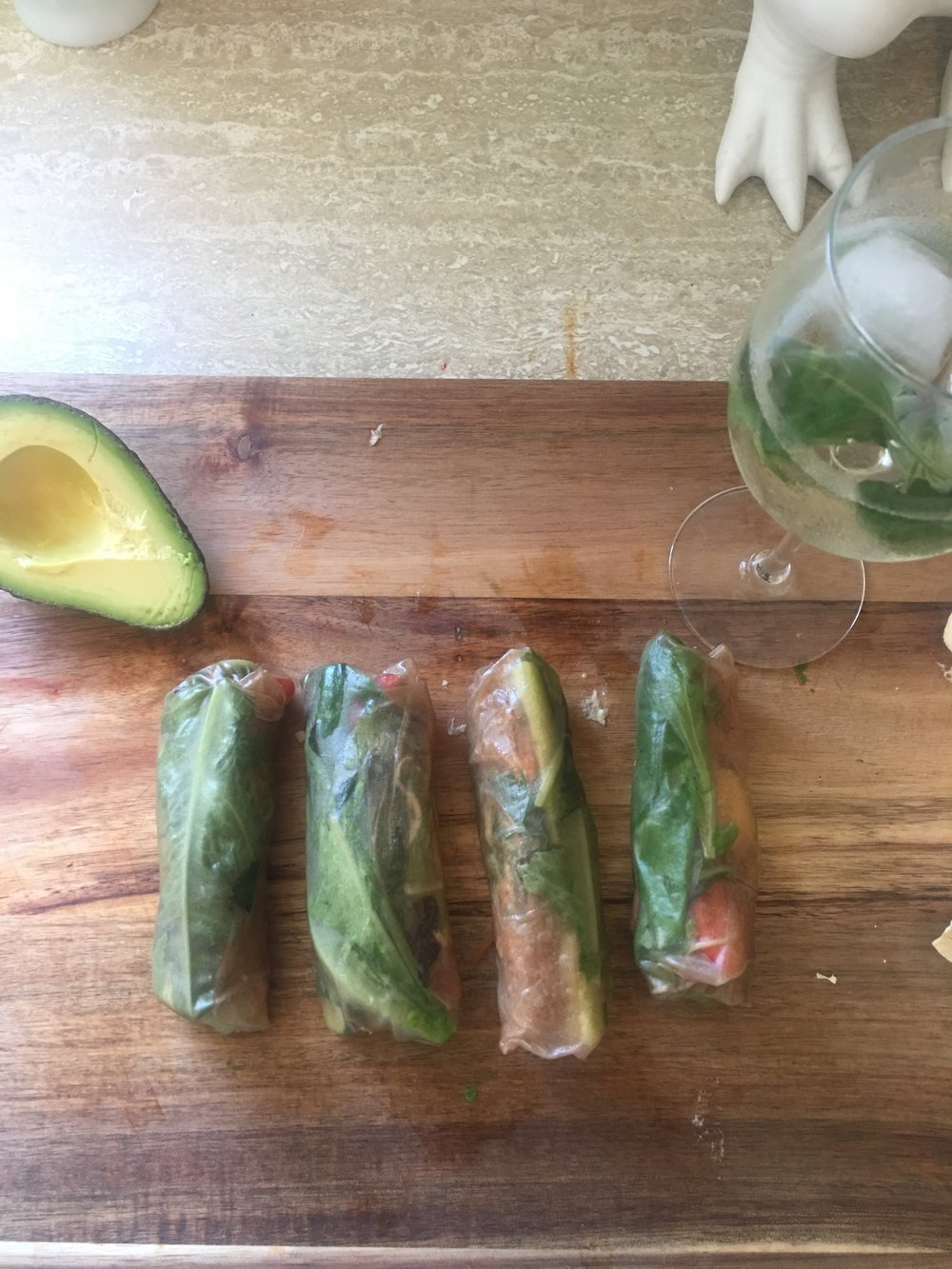 The counterpart to my gas station indulgence. Veggie spring rolls in a brown rice paper wrap. We used lettuce and dill from the garden and added lots of hummus and avo to smooth out the crunchy carrots, and peppers. So good and SO filling.
