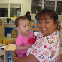 Infant Teacher with child at Maui Family Support services Maui Hawaii
