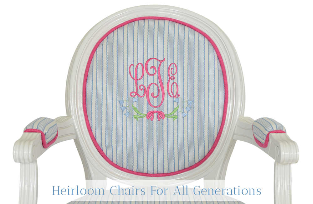 Little Sits chair with blue and white stripe fabric, bright pink welt, and bright pink monogram with flowers.