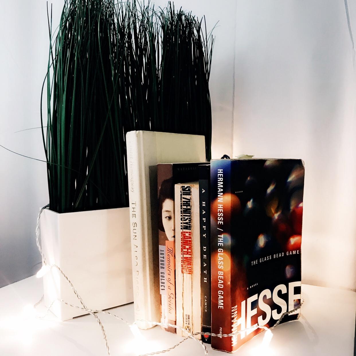 five life-changing books Solzhenitsyn Hemingway Memoirs of a geisha herman hesse glass bead game albert camus a happy death
