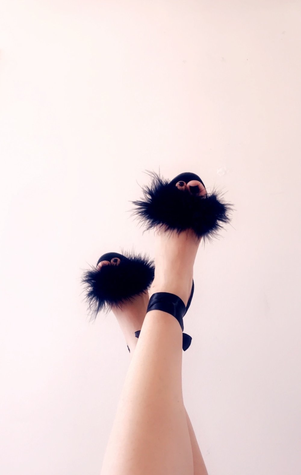 These shoes are actually DIY, which is very simple, just glue some fur to a plain black sandal! - Check out these TopShop sandals if you're not the DIY type.. and they come in pink too!