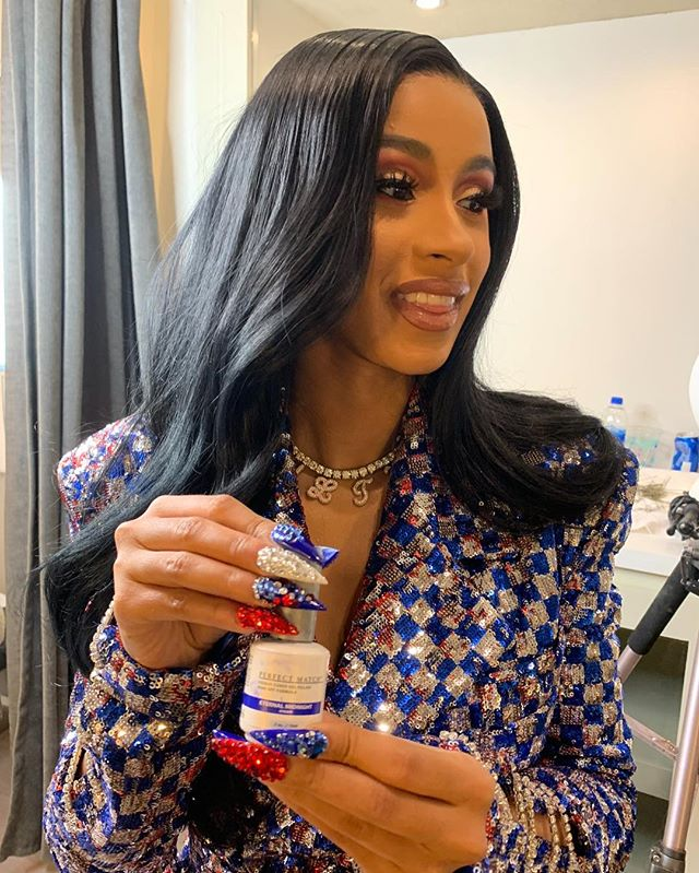 The nails I did for Cardi B's Pepsi Super Bowl commercial using gel colors eternal midnight Red, Flawless White, and  from @lechatnails and rhinestones from @dreamtimecreations.