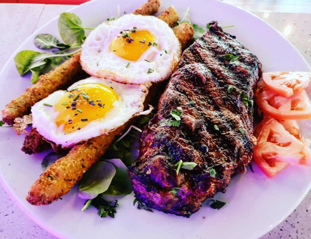 NY STEAK AND EGGS |  grilled 12 oz angus NY strip, fried eggs, asparagus fries