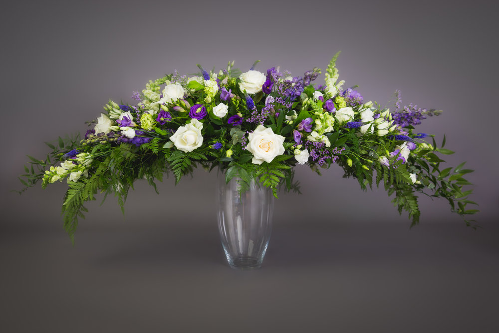 Funeral Flowers. Double ended spray in with and purple including roses, lisianthus and freesia. Available for delivery in Southwick, Brighton, Hove, Portslade, Shoreham and Worthing.
