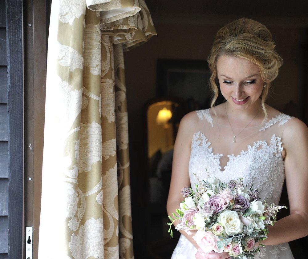 Bride with bridal bouquet. Wedding in Hasting, East Sussex. Wedding flowers and florists in Sussex.
