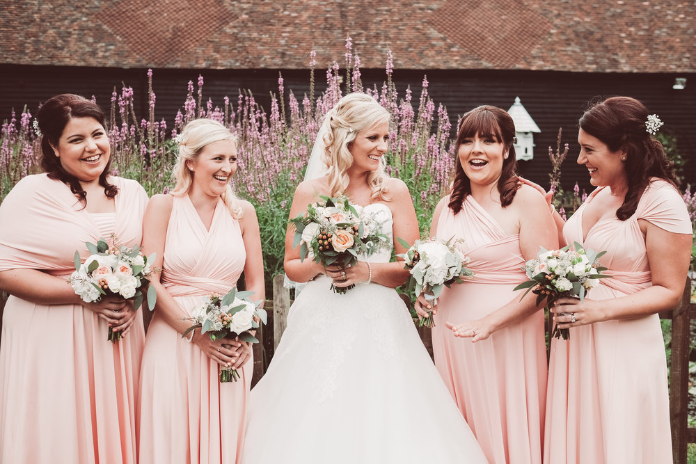 Bride with bridesmaids and bouquets. Wedding in Kent. wedding florist based in Sussex.