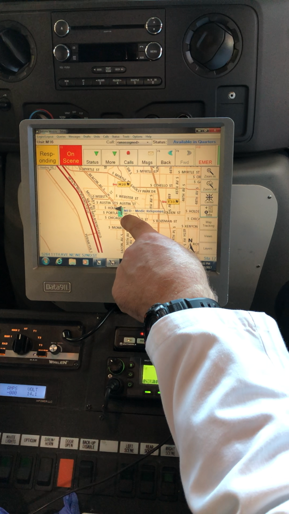 A paramedic showing us the embedded navigation system. - This is a navigation system embedded in both fire engines and ambulances. It allows first responders to view routes, check dispatched calls, see locations of other units, and toggle between working status.