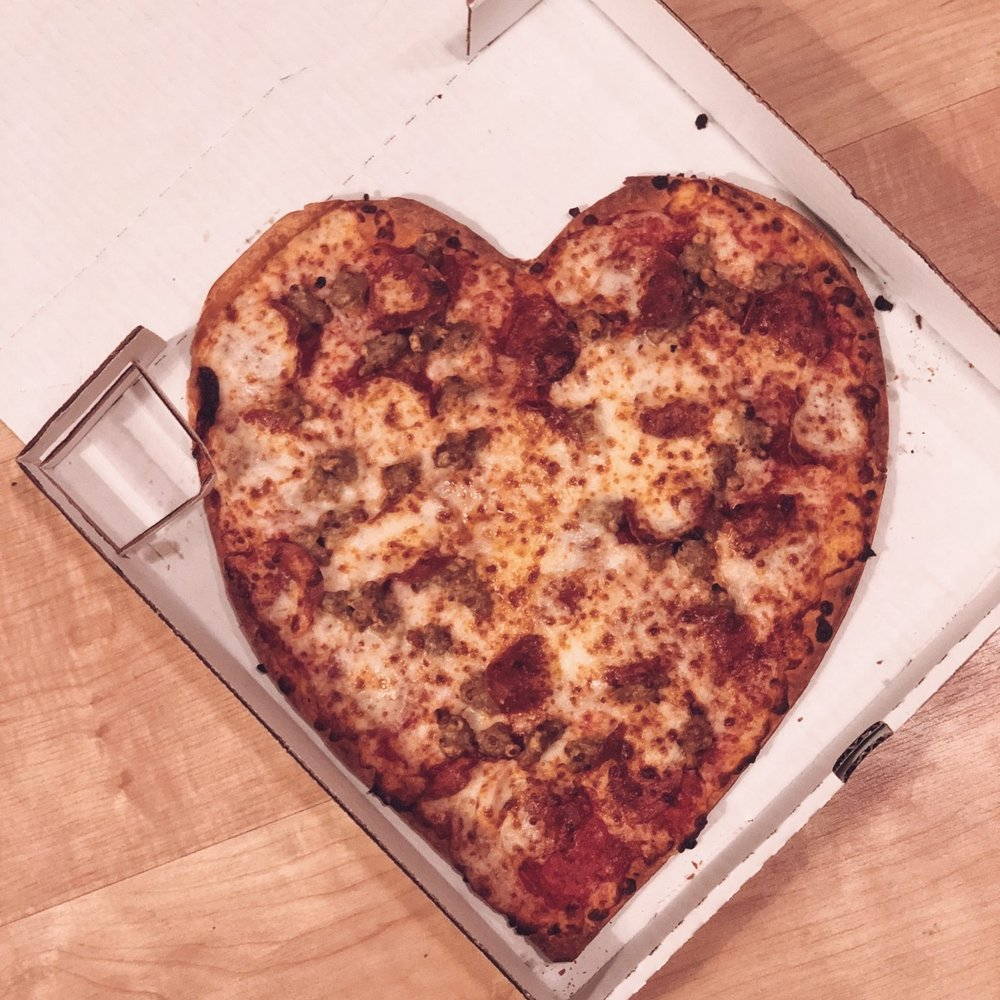 And SURPRISE! - And SURPRISE! Papa John's is doing a heart shaped pizza special which is beyond cute and super instagrammable!