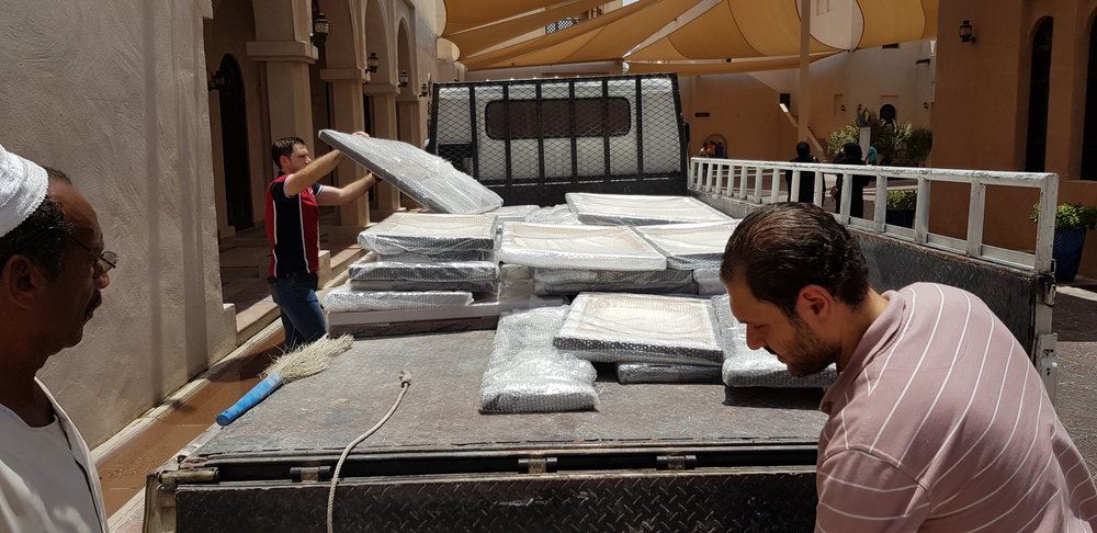 On a hot day! - The day had arrived and we were unloading the photos ready to be hung in the gallery.