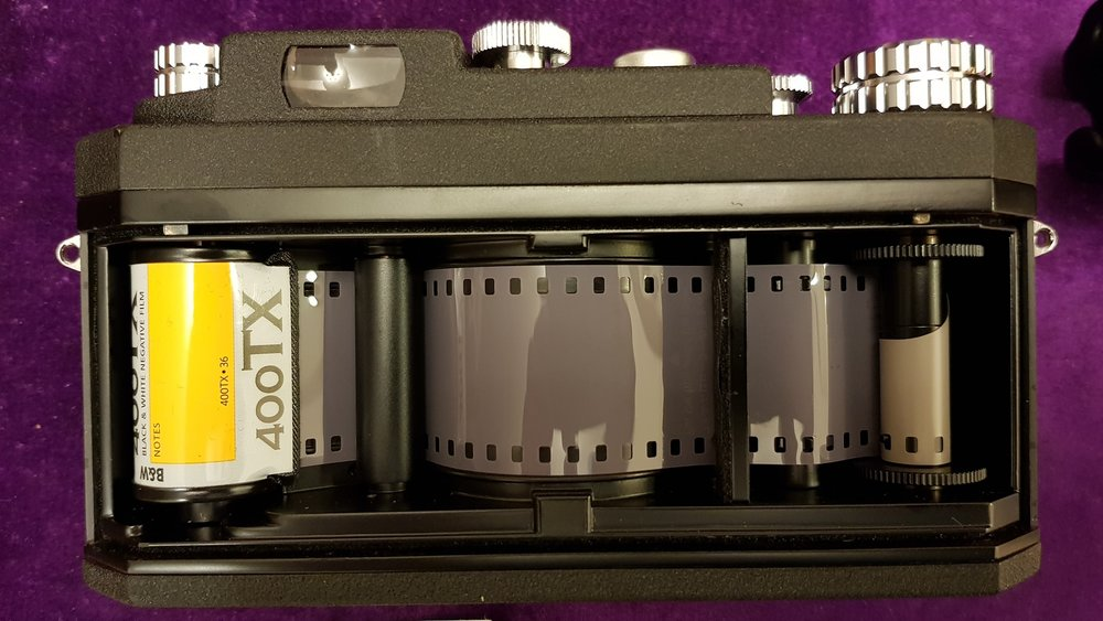 Widelux loaded with 35mm Kodak black and white film.