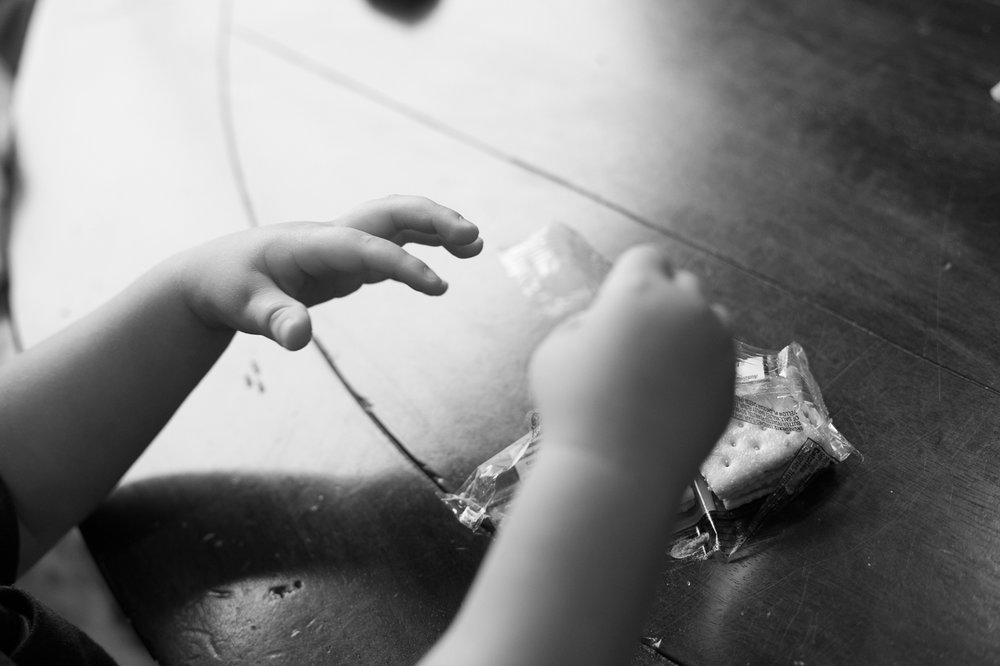 houston family lifestyle photography close up of boy's hands eating crackers