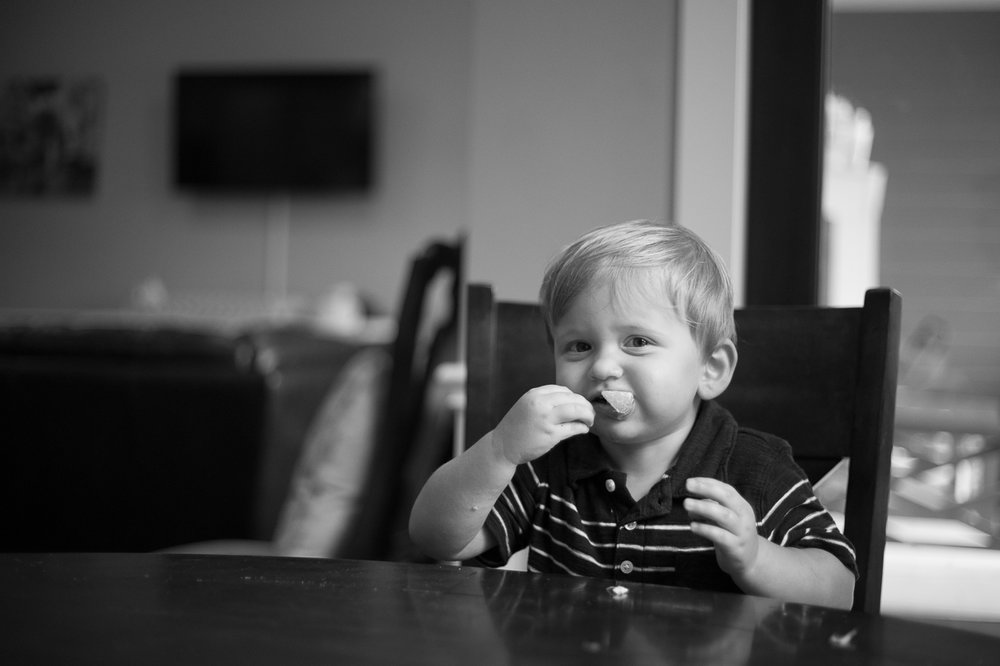 houston family lifestyle photography  boy eating cracker snack