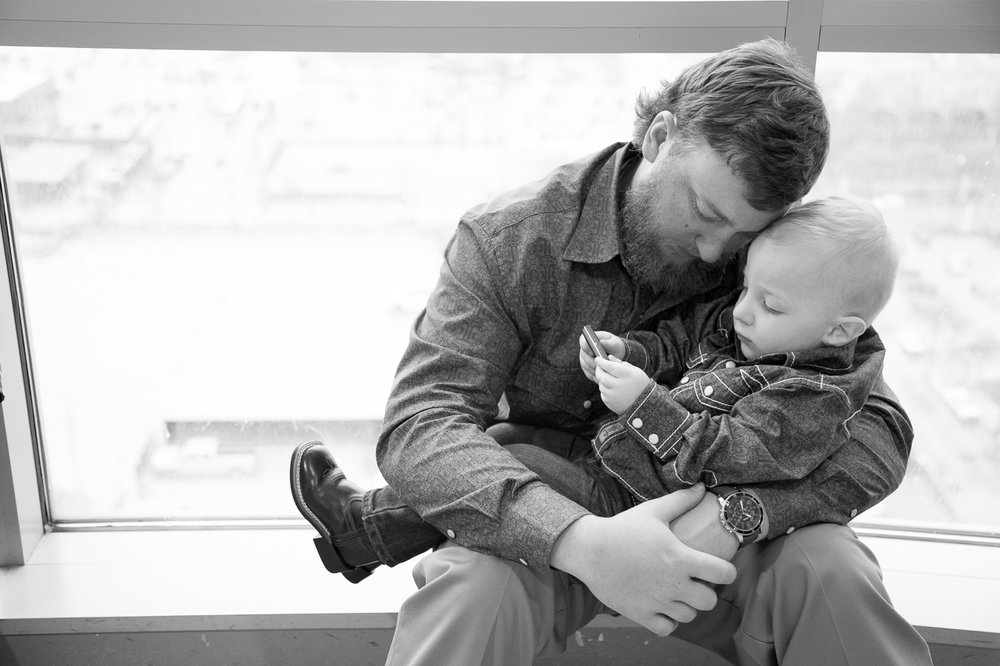adoption day photography dad holds son outside of courtroom