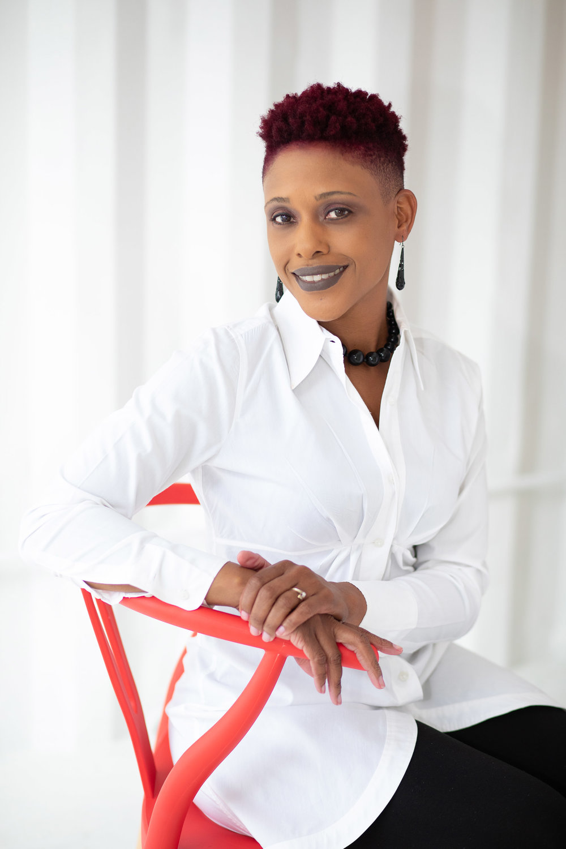 houston studio headshot photography woman in red chair