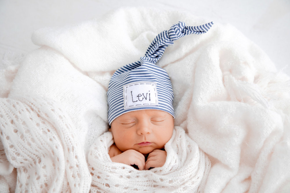 newborn photography baby with pointy hat
