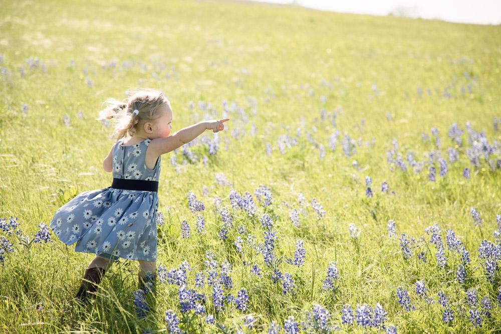 houston-family-photographer-kid-running-bluebonnets.jpg
