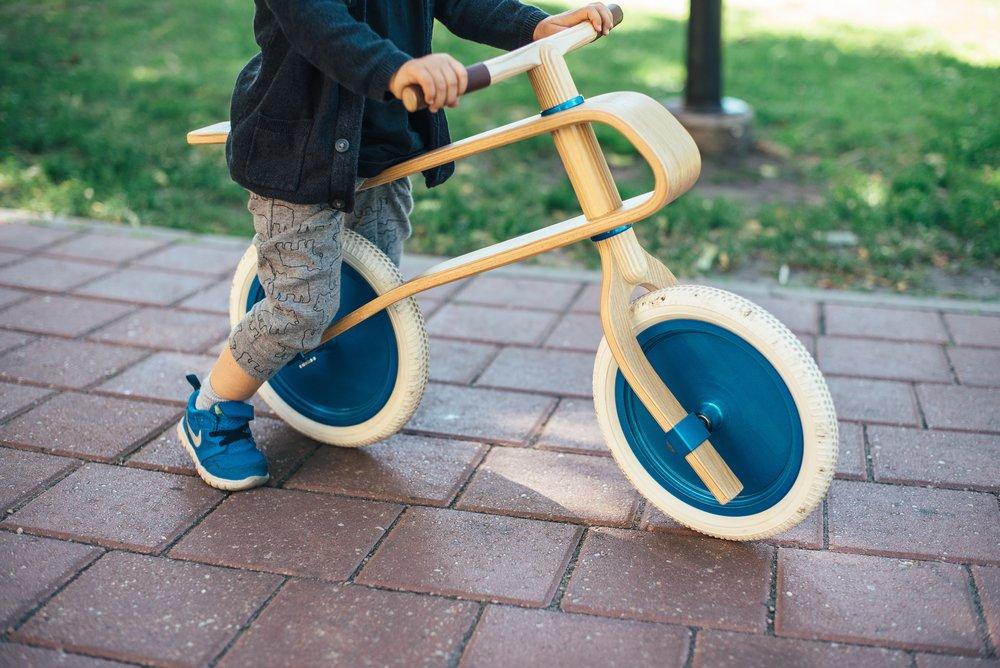 Child boy riding a bike