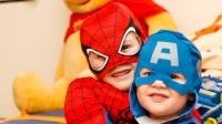 Children boys playing in superhero masks