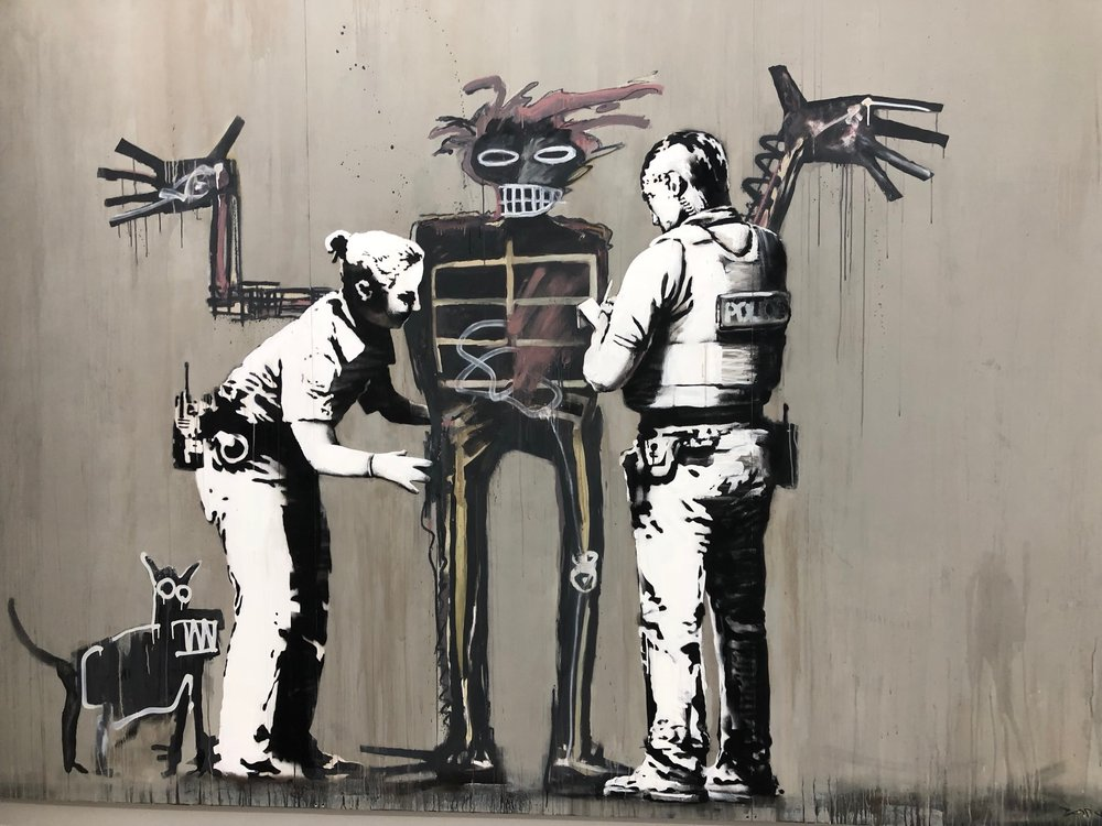 Banksy,  Boy and Dog in a Stop and Search  (2017).