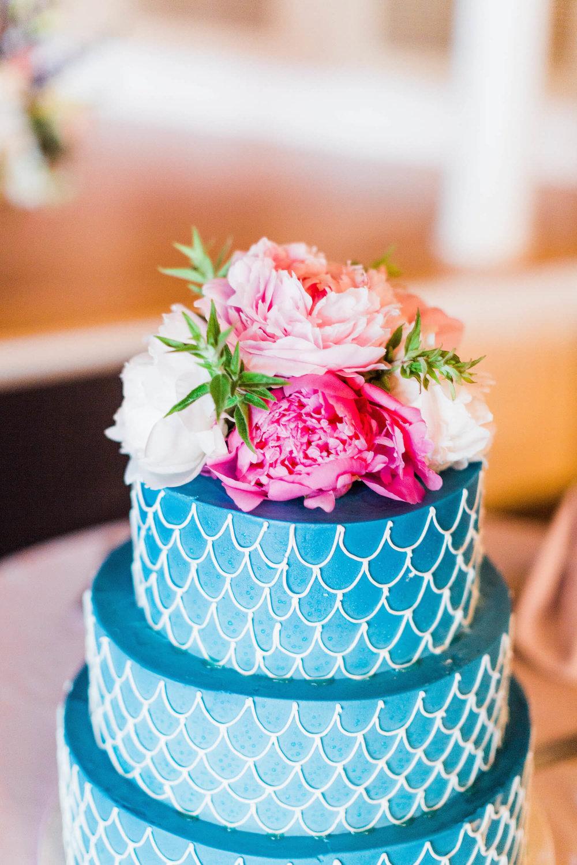 blue-wedding-cake-fish-scales-pink-flowers.jpg