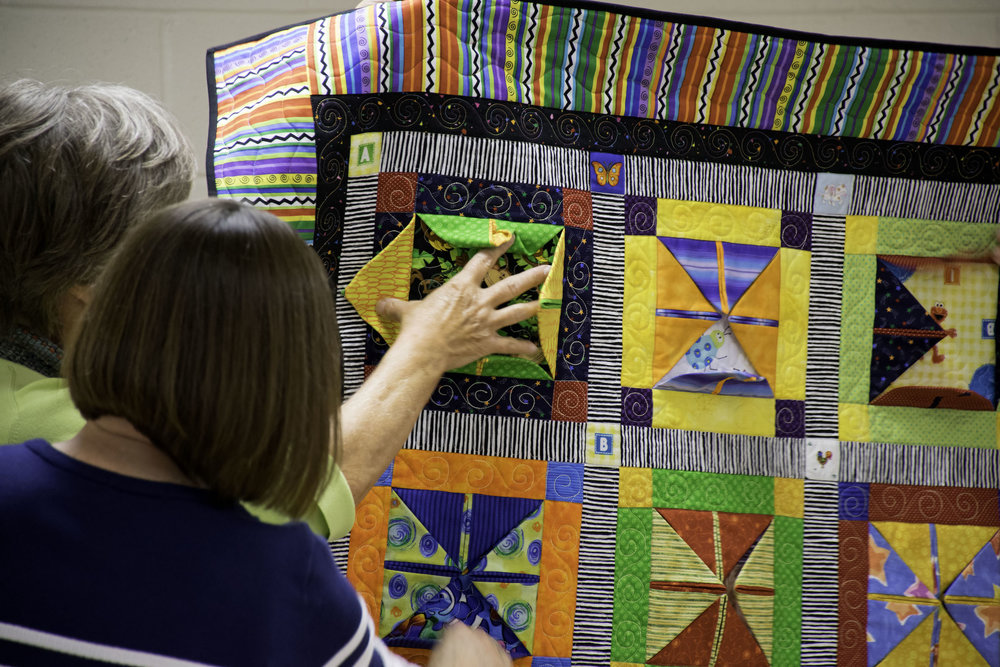 - We share our quilts during