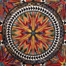 """Click to see """"Five Turns of the Wheel"""" quilt."""
