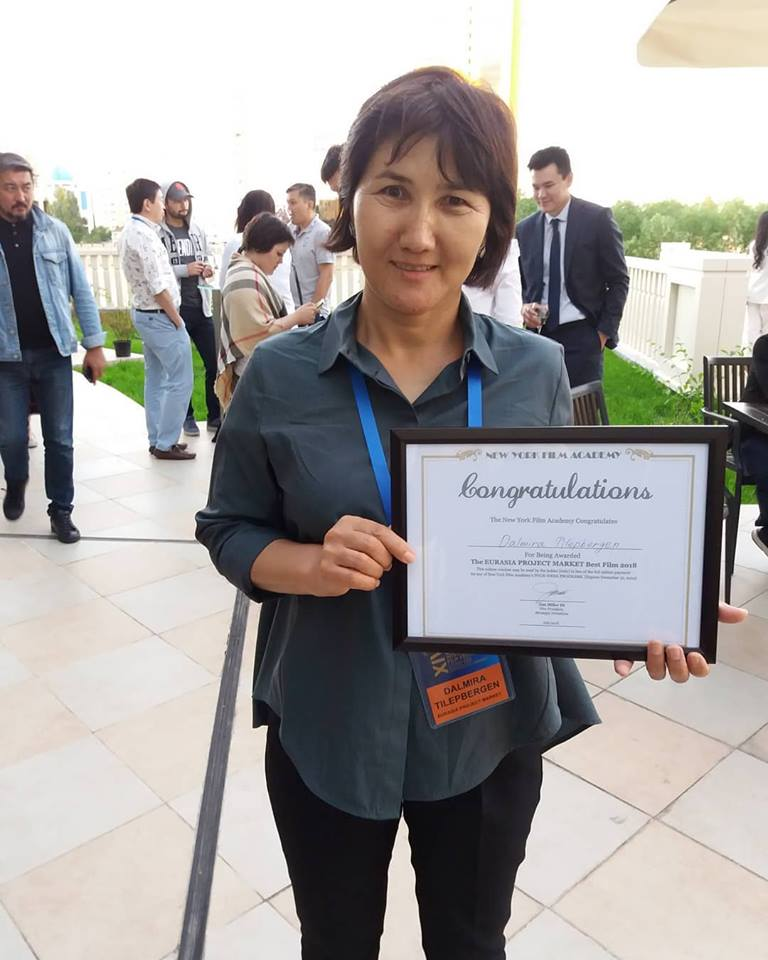 Producer, Screenwriter, Director Dalmira Tilepbergen shows off her award for the best film project at the Eurasia Film Market