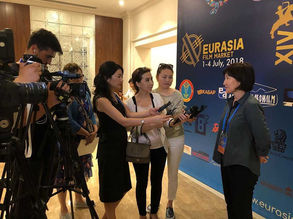 Dalmira Tilepbergen gives an interview at the Eurasia Film Market