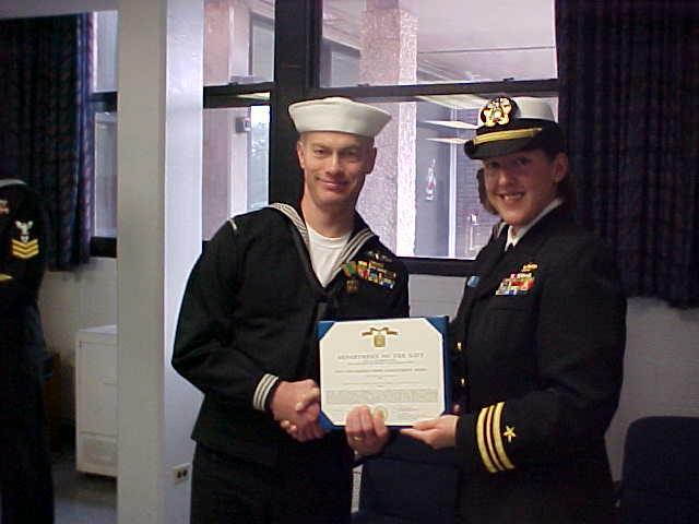 My Commanding Officer presenting me with my fourth Navy and Marine Corps Achievement Medal at my retirement ceremony held on December 7, 2001.