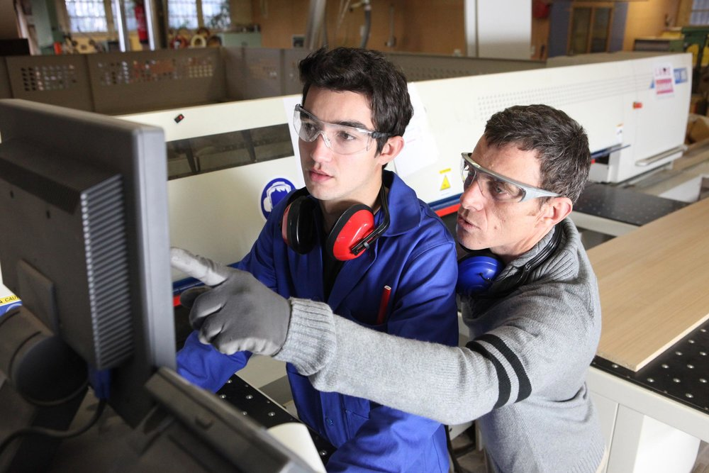 young-apprentice-in-industry-sector-with-tutor.jpg
