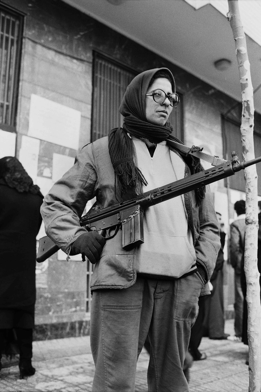 Woman with machine gun.jpg