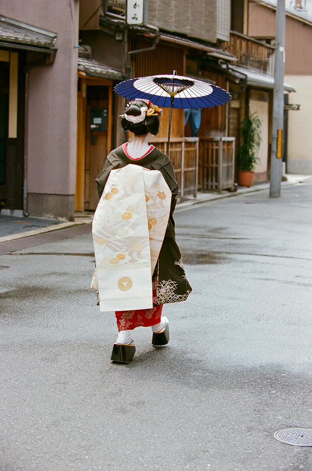 The maiko Makiko of Gion Kobu walks down a rare empty street during Hassaku