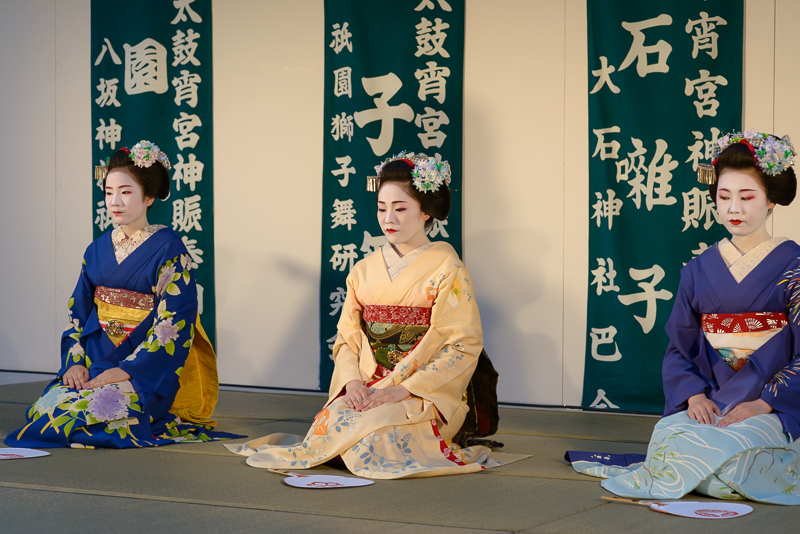 Maiko Manaha, Chisako, and Chiyoko preprare to perform during Gion Matsuri in July