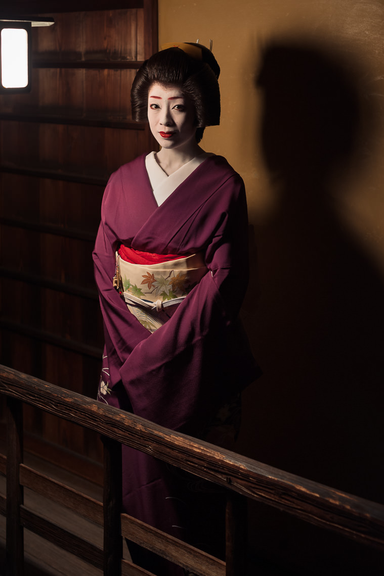 The geisha Makiko surrounded by shadows in Kyoto