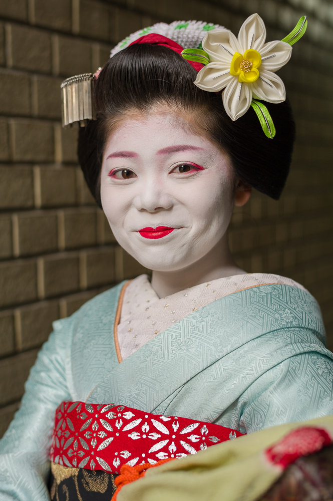 The maiko Momifuku of Ponto-cho tries not to smile for a portrait