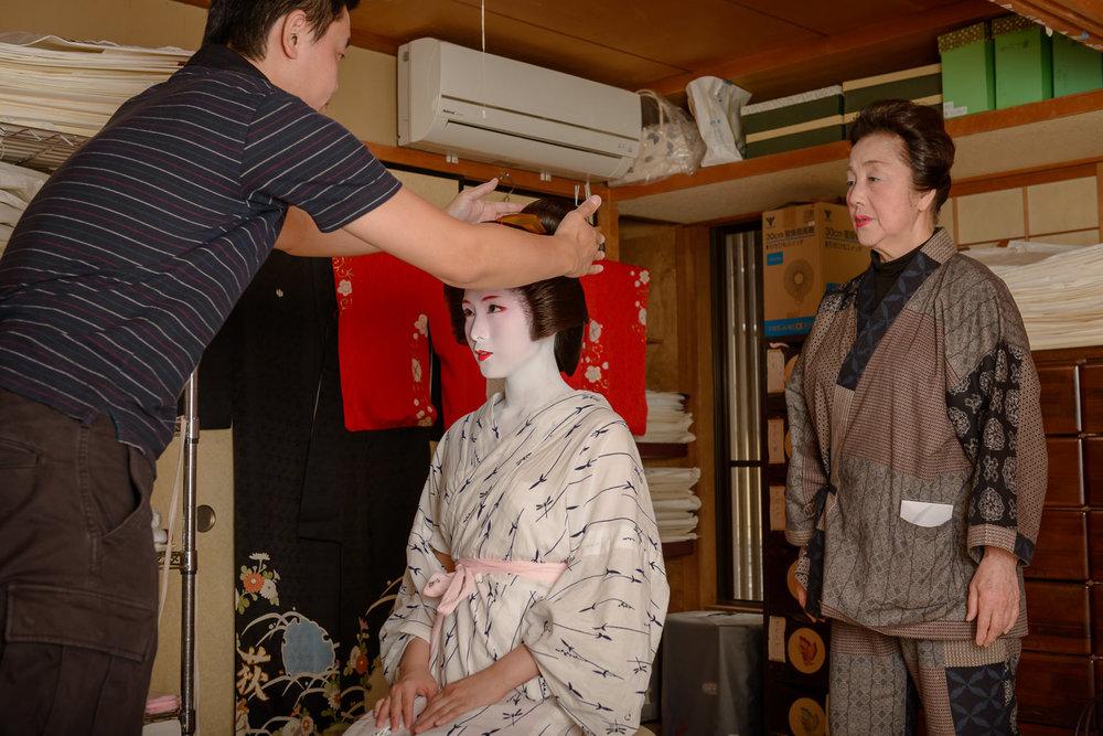 New Geisha Mameharu's katsura is adjusted during her erikae