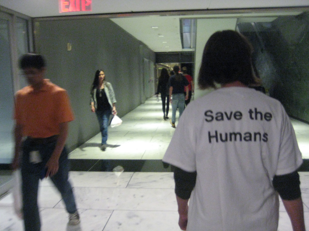 Save the Humans t-shirt worn by climate protester, December 11, 2015, in Houston tunnels
