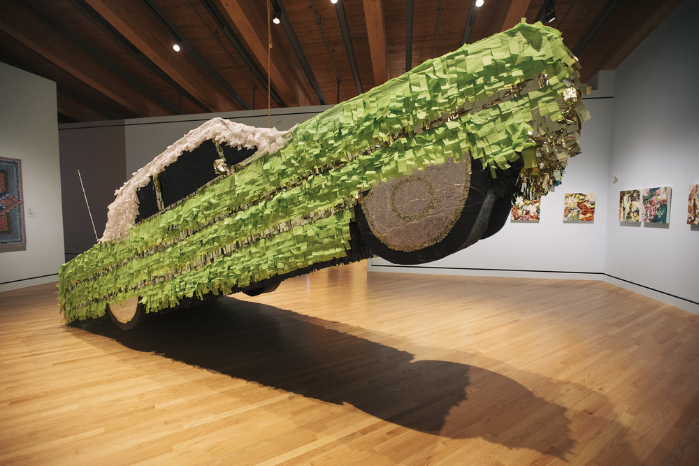 Justin Favela in the group exhibition Con Cariño: Artists Inspired by Lowriders, at the New Mexico Museum of Art in Sante Fe (Photo by Mikayla Whitmore).