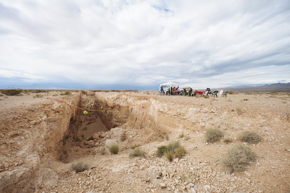 Justin Favela's Family Fiesta at Michael Heizer's Double Negative located in the Moapa Valley on Mormon Mesa near Overton, Nevada on May 9, 2015. (Image courtesy the artist and Nevada Museum of Art, photo credit Mikayla Whitmore)