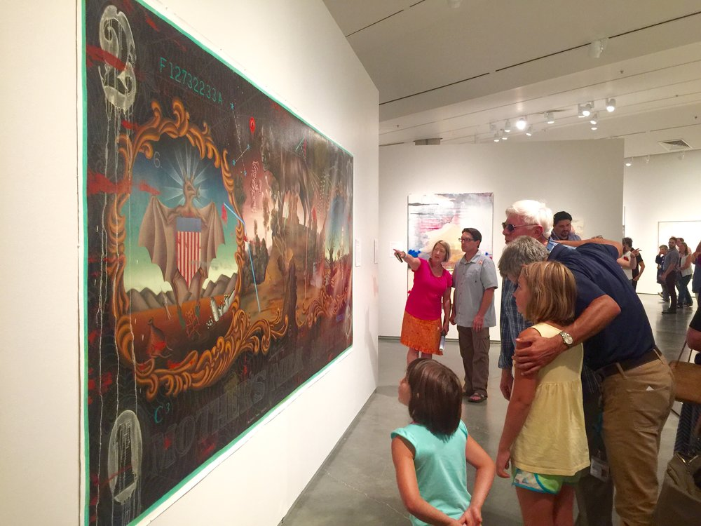 Opening night attendees viewing Matthew Couper's painting Mother's Milk Aquifer, oil on canvas, 2016. (Photo Gig Depio)