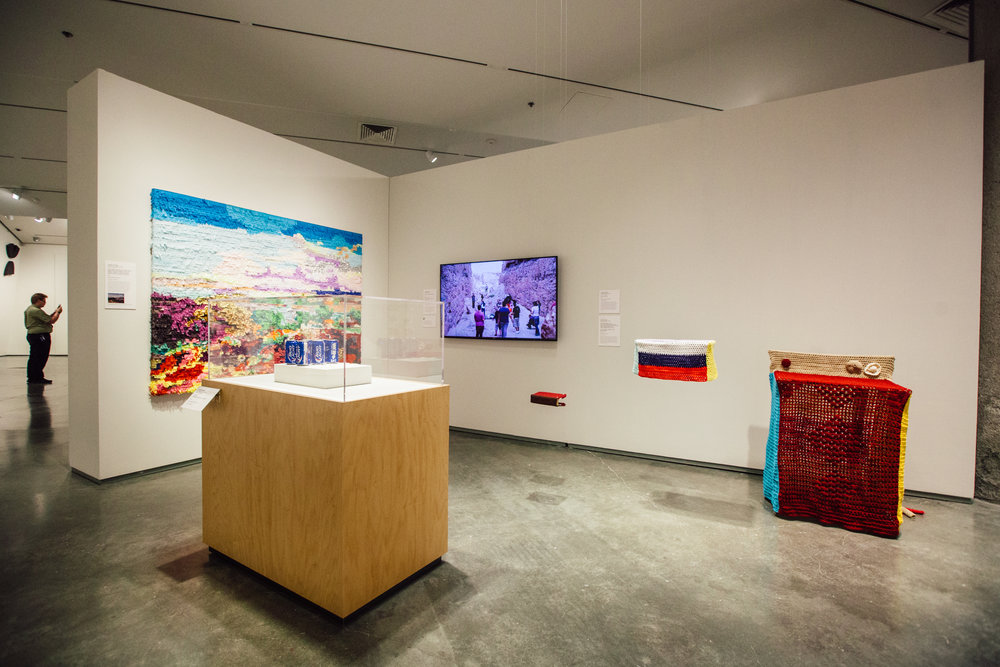 Installation view of Justin Favela's work includes Cubrenos con tu Manto Sagrado (series) 2010-2016 and The Valley of Mexico from the Santa Isabel Mountain Range (Valle de México desde el cerro de Santa Isabel), after Jose Maria Velasco, 2016. (Photo Krystal Ramirez)