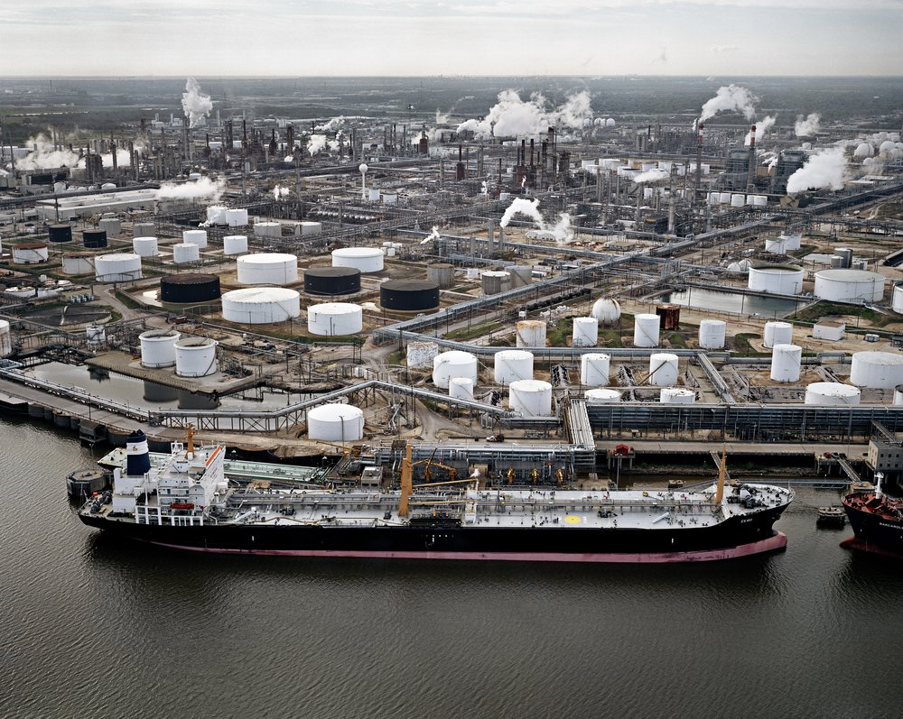 Edward Burtynsky, Oil Tanker and Refineries, Pasadena, Texas, USA, 2004. Chromogenic color print. Collection of the Nevada Museum of Art, The Altered Landscape, Carol Franc Buck Collection. (Photograph © Edward Burtynsky, courtesy Metivier Gallery Toronto / Von Lintel Gallery, Los Angeles)