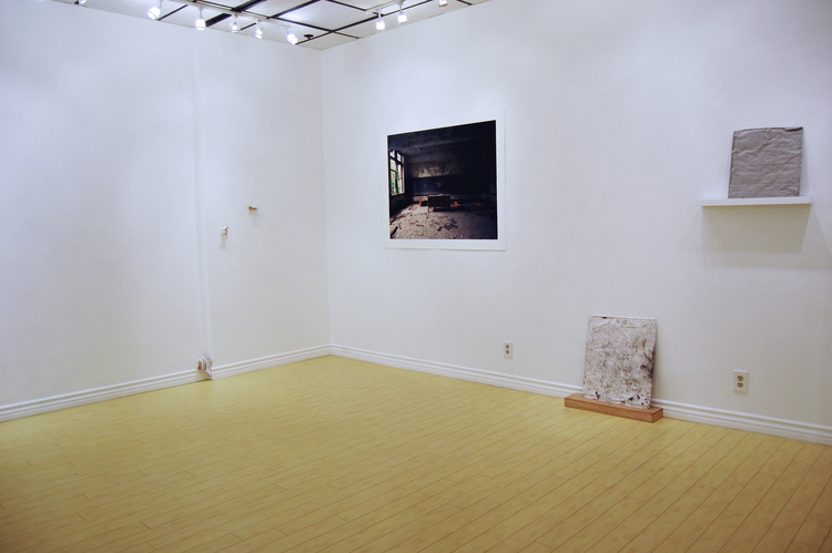 """Earlier installation view of Debris Field at Satellite Contemporary. """"Miscellaneous Debris features the work of gallery founders Nicole Langille, Jared Jelsing, Christopher Kane Taylor, Dennis McGinnis, and DK Sole, whose works range from the conceptual to the figurative, and from sculpture to photography."""" Courtesy Satellite Contemporary."""
