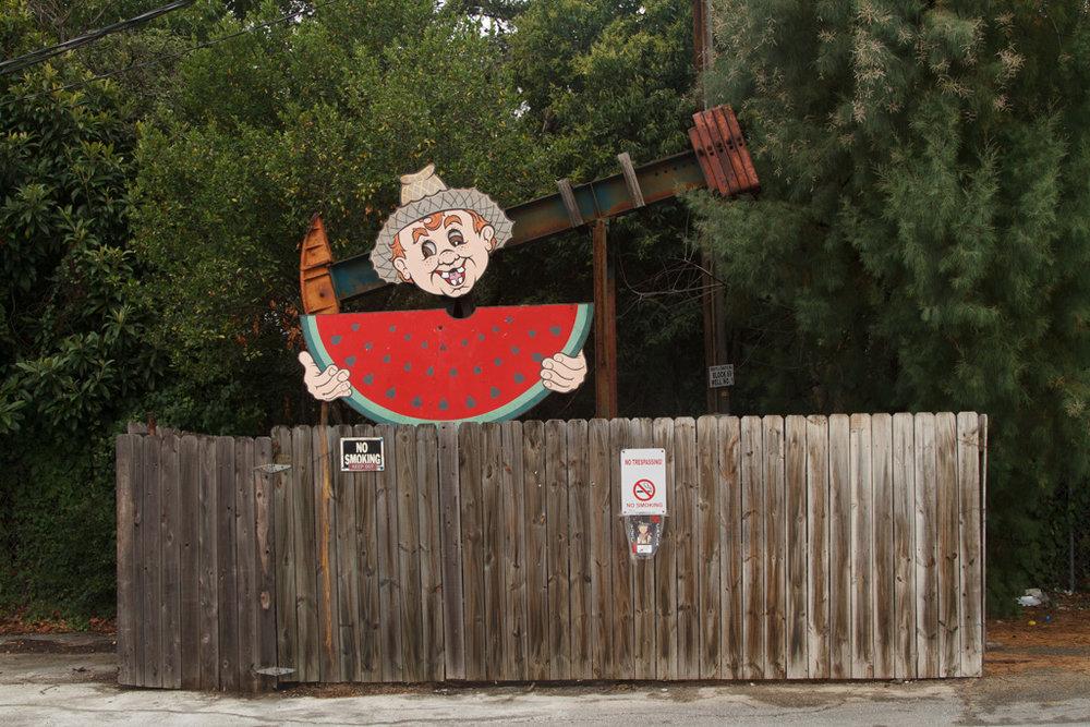 Watermelon Boy , George Kalesik, parking lot next to Dollar General, Luling, Texas. Photo: Laura Napier